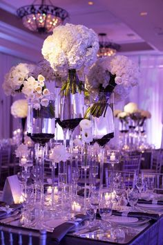 Fabulous #purple #uplighting and #flower #centerpieces at this #wedding #reception! #diy #unique #ideas #inspiration #rentmywedding By #SoniaSharma