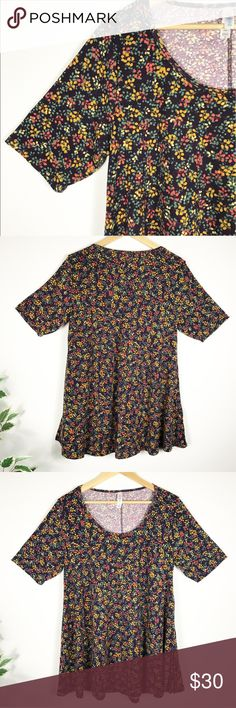 M LULAROE BLACK FLORAL PERFECT TEE NWOT M LULAROE BLACK FLORAL PERFECT TEE New never worn. LuLaRoe's Perfect T boasts a fun swing shape complimented by flirty side slits and a flattering half-sleeve that makes this simple, comfortable top the star of any outfit. Pair it with any of LuLaRoe's skirts and leggings for a look that can't be ignored! Floral print size medium LuLaRoe Tops