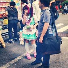 Maid talking to a potential customer on the street, Akihabara, Tokyo.