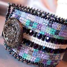 Antique black glass buttons embellish herringbone bead woven bracelet. No damage came to the buttons.     Amazing videos, tips & trends on the latest in celebrity fashions and many more. See more at http://onlineshoppingportals.biz/