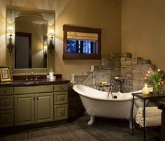 Bathroom - the stone wall behind the clawfoot tub is beautiful, but seems out of place; I would remedy it with a greatly aged paint effect on the walls and probably some rough timbers overhead; wall-hung or pedestal sinks, maybe even a trough.