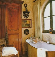 Bathroom in one of Charles previous houses. LOVE the wallpaper and the old bathtub. Such a charming guest bathroom