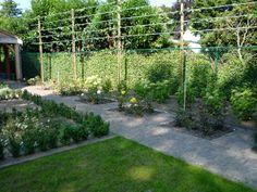 Verhoogd terras van gebakken klinkers met mooi uitzicht op for Tuinen aanleggen foto s