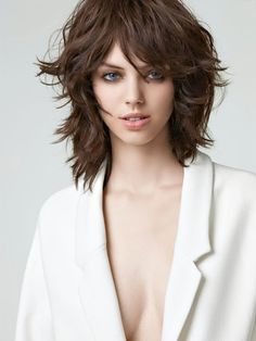 medium length hair cut with layers, texture and bangs .... This is really what I wanted! Not what I ended up with
