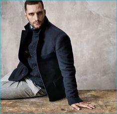 Model Thomaz de Oliveira sports navy fashions from Brunello Cucinelli's fall-winter 2016 collection.