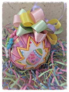 How to make a quilted fabric easter egg quilted ball ornaments eggscelent easter egg fabric quilted spring ornament by wreathsbykari on etsy negle Gallery