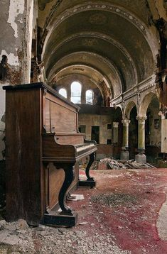A forgotten grand piano in the concert hall of the abandoned town of Pripyat, Chernobyl.