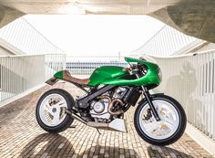 wimoto takes a honda NTV650 motorcycle and turns it into this sinister cafe racer dubbed the green goblin.
