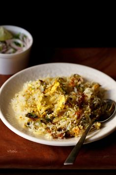 paneer biryani recipe - mildly spiced and delicious dum cooked layered paneer biryani recipe.