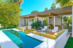 The outdoor living room and fountain | #PalmSprings
