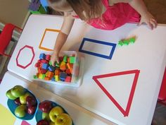 Exploring shapes on the table in preschool