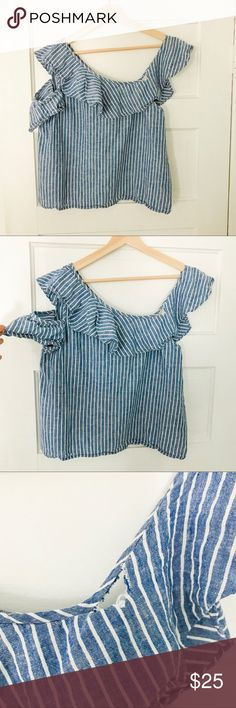 Madewell Off-Shoulder Striped Tank with Ruffle This is the perfect top for a warm spring/summer day! One side has a normal strap and the other has two for a perfect one shoulder look!! So unique!  55% linen, 45% cotton. Machine Wash cold, gentle cycle. Tumble dry low.  **** does have small whole in front at top seam. Should be a quick stitch fix. Price reflects discount for hole. **** Madewell Tops Tank Tops