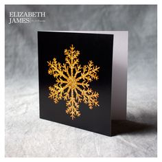 Gold with Black Christmas Card A simple yet stunningly pretty gold snowflake against a black background. All good things come in small packages they say!  Limited edition of 250  Blank inside for your own message with white envelope  individually wrapped in cello bags  Signed and numbered  Made in Britain  12x12cm  helps to fund the fantastic efforts of the woodland trust in protecting and creating our beautiful native woodlands.  330 micron Trucard FSC certified.