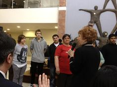 Marilyn praying for new believers in Hungary.