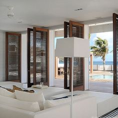 Love the mahogany louver doors all the way up to the ceiling!