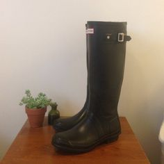 Hunter Rain Boots - Matte Black Awesome authentic Hunter rain boots in the matte black color, size 8, some scuffing on the side of boot (shown in third picture) but not noticeable when you wear the boot, the left boot is also slightly bent from being packed for a few weeks but certainly could be fixed (also very hard to notice when wearing). Price negotiable, please make offers! Hunter Boots Shoes Winter & Rain Boots