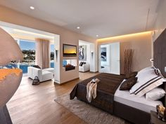 03. An elegant master bedroom with a stunning view.