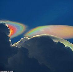 Fire rainbow cloud: The rare phenomenon appeared behind a storm cloud near Delray Beach