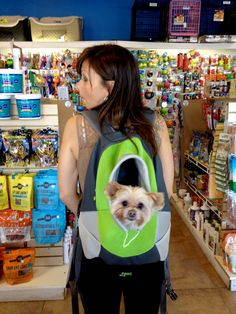 Customer trying on our Sporty Backpacks with their pet. Perfect fit!