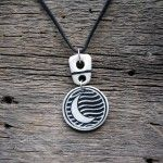 Moon pendant designed by fine artist Cara O'Brien member at Gallery Uptown located in Grand Haven, Michigan.