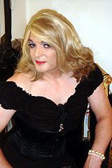 The same gorgeous #transvestite with blond hair.