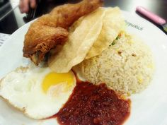 Mum's choice of fried rice with fried chicken that comes with pappadum and sunny side egg