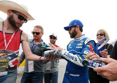 Jimmie Johnson Photos Photos - Jimmie Johnson, driver of the #48 Lowe's Chevrolet, signs autographs for fans during practice for the 59th Annual DAYTONA 500 at Daytona International Speedway on February 25, 2017 in Daytona Beach, Florida. - Daytona International Speedway - Day 9