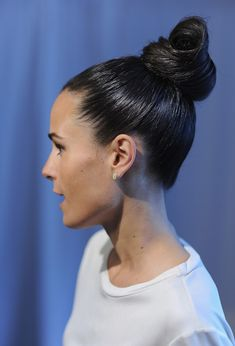 Top Knot: Secure a slicked back bun like this one by Jordana Brewster for a sleek wet-to-dry 'do.