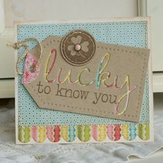 Love the negative of the diecut being made into a tag with a coordinating paper(s) behind it!