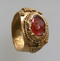 Finger Ring Date: 6th–7th century Culture: Frankish Medium: Gold, carnelian intaglio Dimensions: Overall: 3/4 x 11/16 x 1/2 in. (1.9 x 1.8 x 1.2 cm) bezel: 7/16 x 5/16 in. (1.1 x 0.8 cm)