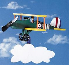 Bi-Plane Whirligig Plan This great whirligig is sure to add to your yards decor. This Bi-Plane will definitely be an attention getter! You can paint it any way you'd like but there is a design include