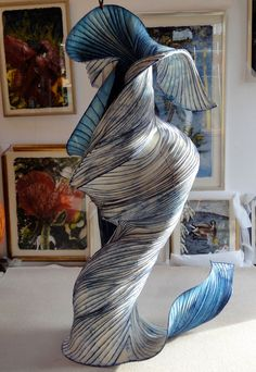 This man's paper sculptures are amazing! They are so fluid, and the colors are stunning!