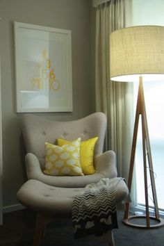half seating reading chair for bedroom at the corner with unique standing lamp and yellow cushions and blanket plus picture on wall decoration #ChairForBedroom