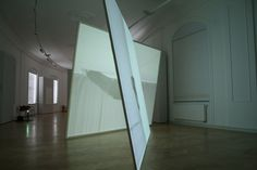 Peter Welz double screen leaning | rotating figure inscribing a circle video projection onto free standing back-projection screens  installation view OTTO DIX PREIS, gera, 2008