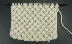 Punto mora o garbanzo, un punto en relieve utilizado en los jerseis tradicionales de Arán. También llamado Blackberry o Trinity Stitch. Paca La Alpaca