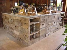 coffee shop with counter made out of old wooden crates.... sooooo creative! Love the cloches instead of expected glass food domes :) great look!