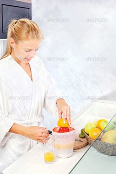 Buy woman making morning juice in kitchen by imarin on PhotoDune. pretty woman making morning juice in kitchen Fitness Nutrition, You Fitness, Juice For Life, Citrus Juicer, No Equipment Workout, Fitness Equipment, Best Sites, Orange, Smooth Skin