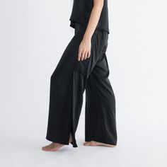 You asked for silk pants, and it was a pretty fantastic idea, so meet our newest Washable Silk Set. For around-the-house coverage, pair with our Cozy Alpaca Pullover or Pima Long Cardigan.   Reversible high/low top features a v-neckline and crossover vented back Pant has a flat front and elasticized back Rear pockets at the back for iPhones and snacks Crossover slit falls from knee and allows ventilation Great for hot and cold sleepers alike Machine wash, cold + lay flat to dry