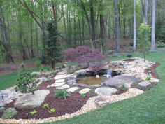 Mountain Boulders accenting a fish pond with Japanese maple Landscape Elements, Landscape Designs, Acreage Landscaping, Outdoor Spaces, Outdoor Decor, Japanese Maple, Flower Beds, Water Features, Bouldering