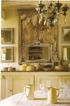 the wall is wonderfully done with architectural elements and mirrors.  Wood beamed ceiling and chandelier  are nice textural elements.