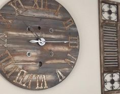 "42"" Large Rustic Spool Wall clock w/ Custom ordered Roman Numerals by HadleeRaeWoodDesigns on Etsy https://www.etsy.com/listing/250826062/42-large-rustic-spool-wall-clock-w"