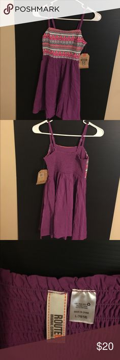 Dress purple multi colored. Very cute Sz. 10/12. Beautiful dress multi colored and a strappy. Sz. 10/12. Very cute and comfy. Make me an offer. Dresses Casual