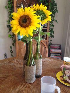 Wine bottle sunflower centerpiece