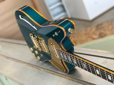 Here is a limited edition, sparkle bound Daylighter Super Supreme in Ocean Turquoise. The Super Supreme features our innovative semi hollow construction that combines a neck and bridge block joined by a hollow section connecting them. Maple front and back over a Spanish Mahogany core and neck, th...