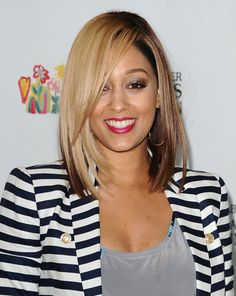 This Summer, Tia Mowry dyed her medium-length cut with a jet-black hue underneath and honey blond around the top layers for a fun two-toned look. Source: Getty / Jason LaVeris