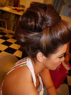 Love the volume in this updo..would love some hair down to frame my face though.