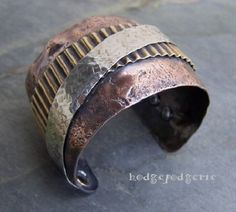 could so do this with supplies on hand from the recycle metal yard.   Industrial Metals Cuff Bracelet