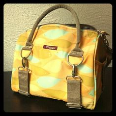 ?? Spring Find! ?? Po Campo Logan Trunk Bag Beautiful, Made in Chicago by woman owned Po Campo! Vegan waxed cotton canvas in retired Yellow Feathers print. Created to be a fashionable handbag as well as a functional cycling bag, secured with sturdy adjustable straps and reflective velcro tabs. Has handles AND adjustable shoulder strap. Inner and outer pockets. Includes matching changing pad if you want to use it as a diaper bag! Tons of compliments on this the few times I used it! Po Campo…