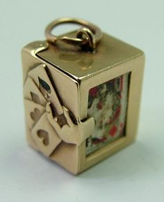 1954 English 9ct gold charm of a box that opens to reveal a pack of playing cards inside, hallmarked for London 1954