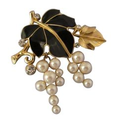 """This finely detailed Monet brooch features clustered  pearl """"grapes"""" complete in a delicious display with black enamel and gold leaves and veins. An excellent compliment for your classy special occasion attire."""